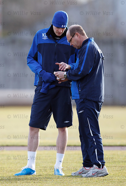 Kyle Lafferty gets his hand strapped up by Pip Yeates