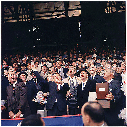 United States President John F. Kennedy throws out first ball at Griffith Stadium in Washington, D.C. on April 10,1961. (first row) Vice President Lyndon B. Johnson, President Kennedy, Dave Powers, Elwood Quesada. (second row) Secretary of Health, Education,and Welfare (HEW) Abraham Ribicoff, Assistant Press Secretary Andrew Hatcher, U.S. Senator Hubert Humphrey (Democrat of Minnesota),  U.S. Senator Everett Dirksen (Republican of Illinois) , U.S. Senator Mike Mansfield (Democrat of Montana). (third row) Lawrence O'Brien, spectators.  The Senators lost the game to the Chicago White Sox 4 - 3..Credit: Robert Knudsen - The White House via CNP