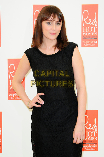 KEELEY HAWES .attends Red magazine's 'Red Hot Women Awards' at the Saatchi Gallery, London, England, UK, .November 30th 2010..half length black dress sleeveless shift hand on hip .CAP/CAS.©Bob Cass/Capital Pictures.
