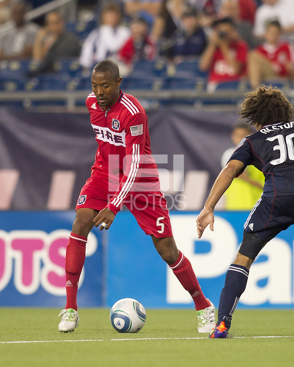 Chicago Fire defender Cory Gibbs (5) on the attack. In a Major League Soccer (MLS) match, the New England Revolution tied the Chicago Fire, 1-1, at Gillette Stadium on June 18, 2011.
