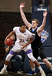 SIOUX FALLS, SD - MARCH 12:  Aziz Leeks #22 from the College of Idaho backs down Bryce Lienhoop #23 from St. Francis during their semifinal game at the 2018 NAIA DII Men's Basketball Championship at the Sanford Pentagon in Sioux Falls. (Photo by Dave Eggen/Inertia)