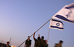 On Israel's last day in Gaza, Israeli soldiers take down Israeli flags at the conclusion of a farewell ceremony from the Gaza Strip, at the Israeli settlements bloc of Gush Katif. Israel completed its pull-out of all Israeli military and civilian presence from the Gaza Strip.