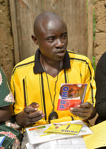Pour Dieu Ukurikiyeyesu  a community health worker in Rwanda specializing  in care for children under five, holds a packet of the anti-malaria medicine, Primo.