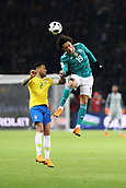 27th March 2018, Olympiastadion, Berlin, Germany; International Football Friendly, Germany versus Brazil; Leroy Sané (Germany) wins the header from Dany Alves (Brazil)