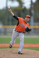 Pitcher Jake Pintar (24) of the Baltimore Orioles organization during a minor league spring training game against the Minnesota Twins on March 20, 2014 at Buck O'Neil Complex in Sarasota, Florida.  (Mike Janes/Four Seam Images)