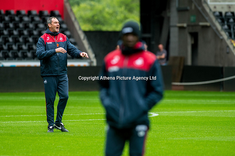 Swansea manager Paul Clement gives instructions to his players during the Swansea City Training Session at The Liberty Stadium, Swansea, Wales, UK. 02 August 2017