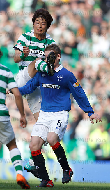 Steven Davis takes a boot in the face from Ki