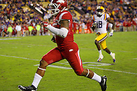 11/14/15<br /> Arkansas Democrat-Gazette/STEPHEN B. THORNTON<br /> Arkansas' Jared Cornelius  turns the corner on his run for the hogs fourth TD  during the fourth quarter of their game Saturday in Baton Rouge, La.