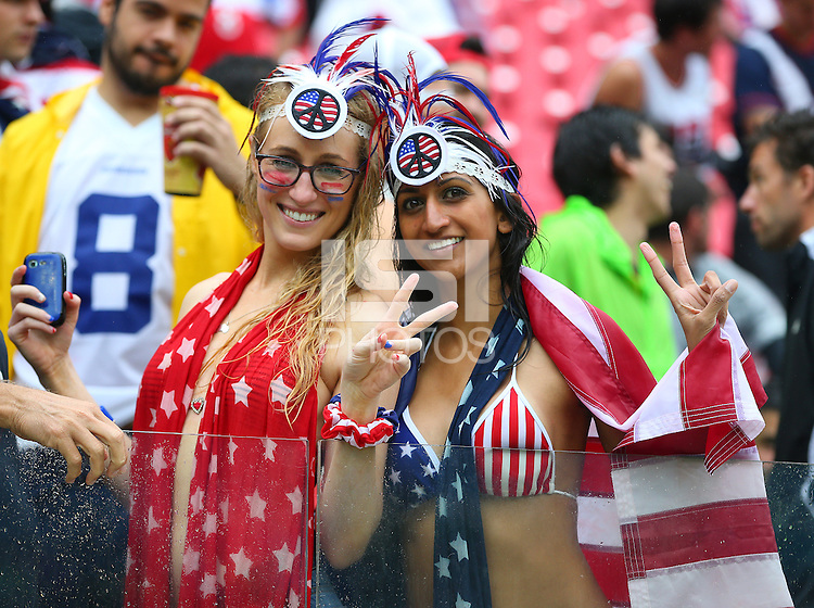 USA supporters celebrate after their progression to the next round