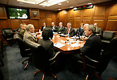 United States President George W. Bush meets with his National Security team in the White House Situation Room, Friday, March 10, 2006, on the latest developments in Iraq. At the table are US Vice President Dick Cheney; White House Chief of Staff Andy Card; National Security Advisor Stephen Hadley; National Intelligence Director John Negroponte; Central Intelligence Agency Director Porter Goss; US Army General John Abizaid; Chairman Joint Chiefs of Staff US Marine Corps General Peter Pace; US Secretary of Defense Donald Rumsfeld and US Secretary of State Condoleezza Rice. On screen are US Ambassador to Iraq Zalmay Khalilzad, left,  and US Army General George Casey. Seated at far-right are White House Counsel Harriet Miers and Deputy National Security Advisor J. D. Crouch. <br /> Mandatory Credit: Eric Draper / White House via CNP