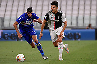 Mehdi Leris of UC Sampdoria and Cristiano Ronaldo of Juventus compete for the ball during the Serie A football match between Juventus FC and UC Sampdoria at Juventus stadium in Turin (Italy), July 26th, 2020. Play resumes behind closed doors following the outbreak of the coronavirus disease. <br /> Photo Federico Tardito / Insidefoto