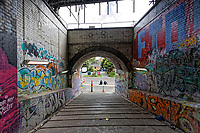 Graffitis on the walls of the pedestrian access tunnel connecting the Strand with the High Street, Swansea, Wales, UK. Thursday 16 August 2018