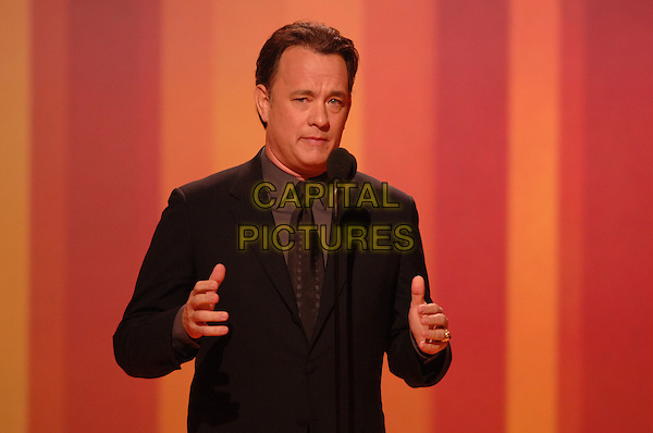 "TOM HANKS.Presents the Cecille B. DeMille award.Telecast - 64th Annual Golden Globe Awards, Beverly Hills HIlton, Beverly Hills, California, USA..January 15th 2007. .globes half length black suit jacket microphone hands.CAP/AW.Please use accompanying story.Supplied by Capital Pictures.© HFPA"" and ""64th Golden Globe Awards"""