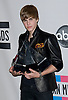 "JUSTIN BIEBER WITH HIS COLLECTION OF AWARDS.American Music Awards 2010,Nokia Rheatre, Los Angeles_21/10/2010.Mandatory Photo Credit: ©Dias/Newspix International..**ALL FEES PAYABLE TO: ""NEWSPIX INTERNATIONAL""**..PHOTO CREDIT MANDATORY!!: NEWSPIX INTERNATIONAL(Failure to credit will incur a surcharge of 100% of reproduction fees)..IMMEDIATE CONFIRMATION OF USAGE REQUIRED:.Newspix International, 31 Chinnery Hill, Bishop's Stortford, ENGLAND CM23 3PS.Tel:+441279 324672  ; Fax: +441279656877.Mobile:  0777568 1153.e-mail: info@newspixinternational.co.uk"
