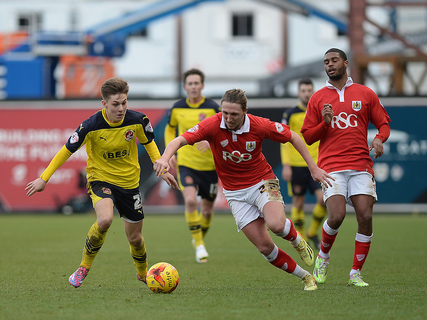 Fleetwood Town's Nick Haughton vies for possession with Bristol City's Luke Ayling<br /> <br /> Photographer Ashley Crowden/CameraSport<br /> <br /> Football - The Football League Sky Bet League One - Bristol City v Fleetwood Town - Sunday 1st February 2015 - Ashton Gate - Bristol<br /> <br /> &copy; CameraSport - 43 Linden Ave. Countesthorpe. Leicester. England. LE8 5PG - Tel: +44 (0) 116 277 4147 - admin@camerasport.com - www.camerasport.com