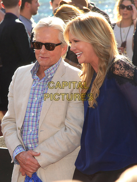 Michael Douglas, Nancy O'Dell<br /> &quot;Last Vegas&quot; cast received the key to Vegas at the Bellagio Fountain, Las Vegas, NV, USA, 18th October 2013.<br /> half length sunglasses beige suit blue checked shirt plaid green <br /> CAP/ADM/MJT<br /> &copy; MJT/AdMedia/Capital Pictures