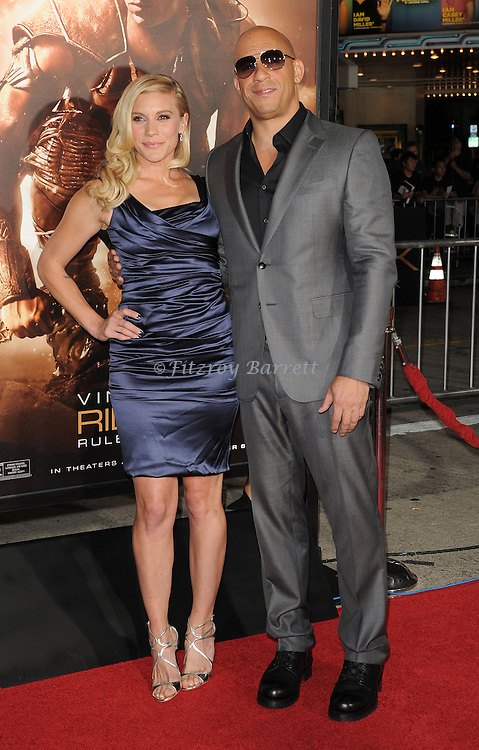 Katee Sackhoff and Vin Diesel at the RIDDICK World Premiere, held at the Regency Village Theater Los Angeles, Ca. August 28, 2013