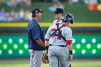 Salem Red Sox pitching coach Paul Abbott (44) has a meeting on the mound with starting pitcher Daniel McGrath (18) and catcher Jordan Procyshen (34) during the game against the Winston-Salem Dash at BB&T Ballpark on June 16, 2016 in Winston-Salem, North Carolina.  The Dash defeated the Red Sox 7-1.  (Brian Westerholt/Four Seam Images)