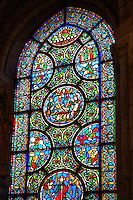 Medieval stained glass window showing scenes from The Apocolypse. The Gothic Cathedral Basilica of Saint Denis ( Basilique Saint-Denis ) Paris, France. A UNESCO World Heritage Site.