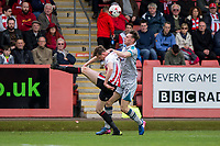 William Boyle of Cheltenham Town clears from Calum Dyson of Grimsby during the Sky Bet League 2 match between Cheltenham Town and Grimsby Town at the The LCI Rail Stadium,  Cheltenham, England on 17 April 2017. Photo by PRiME Media Images / Mark Hawkins.