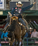 Jacobs Crawley rides in the Saddle Bronc Riding event during the Reno Rodeo on Sunday, June 23, 2019.