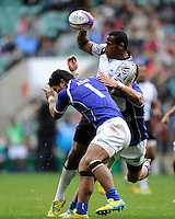 Watisoni Votu of Fiji offloads as he is tackled by Afa Aiono of Samoa during the iRB Marriott London Sevens at Twickenham on Saturday 11th May 2013 (Photo by Rob Munro)