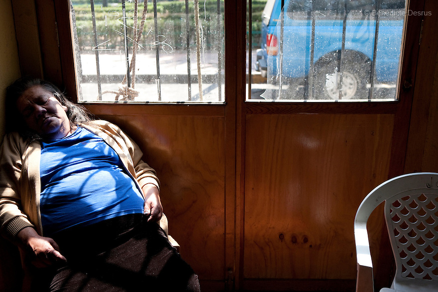 Canela, a resident of Casa Xochiquetzal, rests in the corner of the kitchen at the shelter in Mexico City, Mexico on February 25, 2009. Casa Xochiquetzal is a shelter for elderly sex workers in Mexico City. It gives the women refuge, food, health services, a space to learn about their human rights and courses to help them rediscover their self-confidence and deal with traumatic aspects of their lives. Casa Xochiquetzal provides a space to age with dignity for a group of vulnerable women who are often invisible to society at large. It is the only such shelter existing in Latin America. Photo by Bénédicte Desrus
