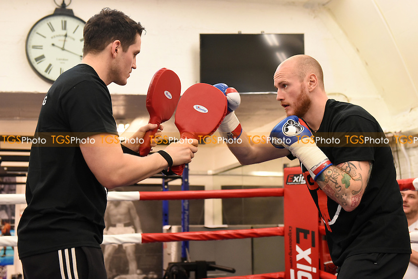 George Groves performs some pad work with trainer Shan McGuigan at his Hammersmith Gym