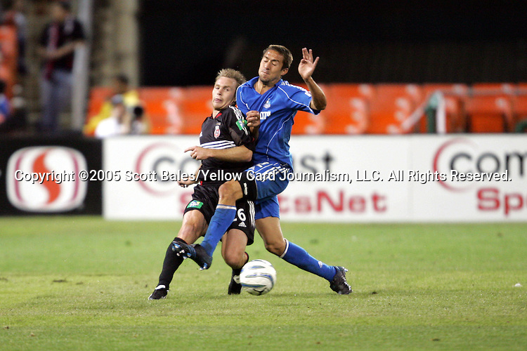 21 May 2005: DC United's Bryan Namoff (left) and Kansas City's Davy Arnaud collide. DC United defeated the Kansas City Wizards 3-2 at RFK Stadium in Washington, DC in a regular season Major League Soccer game. . .