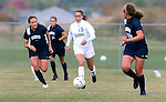 BROOKINGS, SD - OCTOBER 12: Alyssa Brazil #15 from South Dakota State pushes the ball through the defense of  Ashley Martin #3 and Mariah Morgan #20 from Oral Roberts University in the first half of their game Sunday afternoon at Fischback Soccer Field in Brookings. (Photo by Dave Eggen/Inertia)
