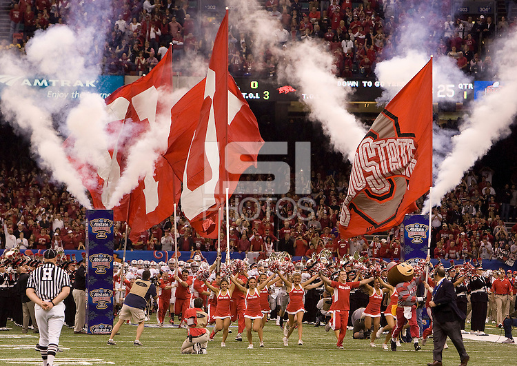 Ohio State football players and cheerleaders run on the field before the game during 77th Annual Allstate Sugar Bowl Classic at Louisiana Superdome in New Orleans, Louisiana on January 4th, 2011.  Ohio State defeated Arkansas, 31-26.