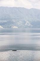 Fishing boat on Lake Toba (Danau Toba), the largest volcanic lake in the world, North Sumatra, Indonesia