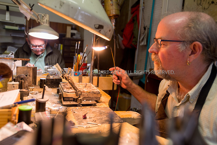 10/24/2015 &mdash; Victoria, British Columbia, Canada<br /> <br /> MacDonald Jewellery on Trounce Alley. Here jeweler Ian Horridge (right) and Ian MacDonald work. Trounce alley is a diverse micro hub where old-world businesses coexist alongside hip new shops and restaurants, none of which disrupt the pathway&rsquo;s quaint charm.<br /> <br /> <br /> Trounce Alley is a discrete passage connecting two main thoroughfares in downtown Victoria, British Columbia. It has a long history as a commercial strip, albeit a tiny one. It goes back to the mid-1800s when developer and architect Thomas Trounce designed the lane to provide easy access to stores he owned.<br /> <br /> <br /> Photograph by Stuart Isett<br /> &copy;2015 Stuart Isett. All rights reserved.