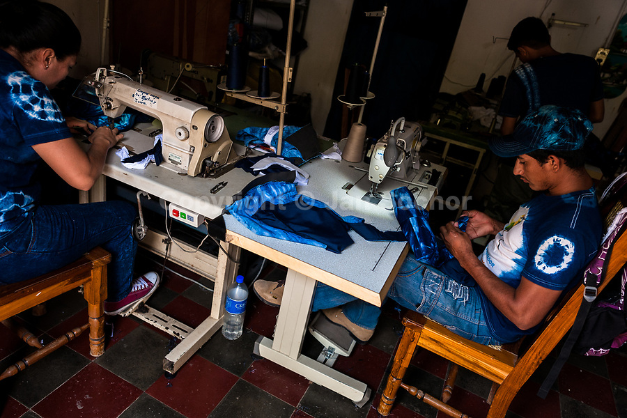 A Salvadoran seamster sews an indigo-dyed tote bag on the sewing machine in an artisanal clothing workshop in Santiago Nonualco, El Salvador, 6 April 2018. For centuries, indigo, a natural deep blue dye extracted from the leaves of tropical plants, has been known to the native indigenous inhabitants of Central America. Nowadays, a growing demand for handmade, nature-based products has has permitted the emergence of various clothing workshops and cooperatives. Employing traditional design techniques and inspired by the ancient Mayan artists, they produce fashion collections, clothing accessories or decorative items on a sustainable, small scale basis.