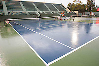 STANFORD-March 30, 2013: Rain on courts during the Stanford vs UCLA tennis match Saturday afternoon at the Taube Family Tennis Stadium before the match was halted because of rain.<br /> <br /> When the match resumed on Sunday UCLA won 5-2.