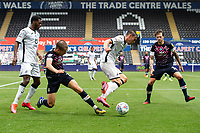 Connor Roberts of Swansea City under pressure from Dan Potts of Luton Town during the Sky Bet Championship match between Swansea City and Luton Town at the Liberty Stadium in Swansea, Wales, UK. Saturday 27 June 2020.