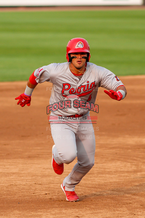 Peoria Chiefs catcher Ivan Herrera (4) races to third base during a Midwest League game against the Wisconsin Timber Rattlers on May 31, 2019 at Fox Cities Stadium in Appleton, Wisconsin. Peoria defeated Wisconsin 3-0. (Brad Krause/Four Seam Images)