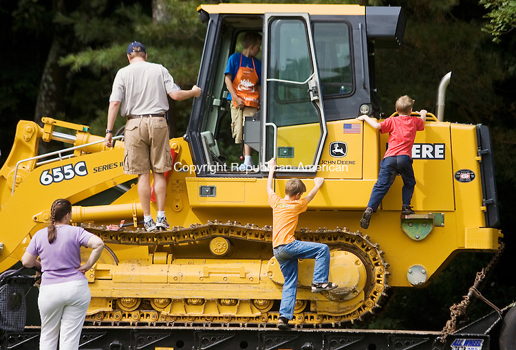 WOODBURY--13 September 2008--091308TJ02 - Curt Nadeau, from left, of Simsbury, his son Tyler, 8, and brothers Colby, 11, and Eli Skilton, 8, of Morris, climb over a bulldozer during the 'Big Wheels at Brodie Park' in New Hartford on Saturday, September 13, 2008. (T.J. Kirkpatrick/Republican-American)