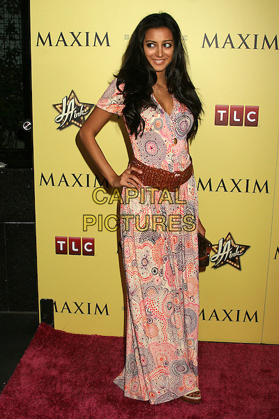 NOUREEN DeWULF.LA INK Premiere Party at the Sofitel Hotel's Stone Rose Lounge, Los Angeles, California, USA..August 6th, 2007.full length pink purple red pattern dress hand on hip weave braid plait belt wide .CAP/ADM/BP.©Byron Purvis/AdMedia/Capital Pictures