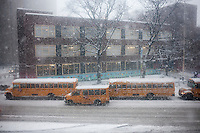 "School buses discharge their students outside Public School 33 in the Chelsea neighborhood of New York on Thursday, February 13, 2014. The NYC Dept. of Education has not declared a ""snow day"" during this winter storm which is expected to dump at least six inches onto the metropolitan area.  (© Richard B. Levine)"
