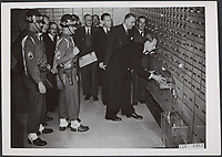 Stolen diamonds from Germany back. American occupation authorities in Germany returned millions of diamonds stolen by the Germans from the Netherlands, which were received in the Amsterdam Bank in Amsterdam in the presence of Minister Huysmans (third from right). The diamonds are under strict supervision of the American M.P. salvaged in the safes Date: August 28, 1947