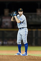 Surprise Saguaros relief pitcher Grant Gavin (54), of the Kansas City Royals, gets ready to deliver a pitch during an Arizona Fall League game against the Scottsdale Scorpions at Scottsdale Stadium on October 15, 2018 in Scottsdale, Arizona. Surprise defeated Scottsdale 2-0. (Zachary Lucy/Four Seam Images)