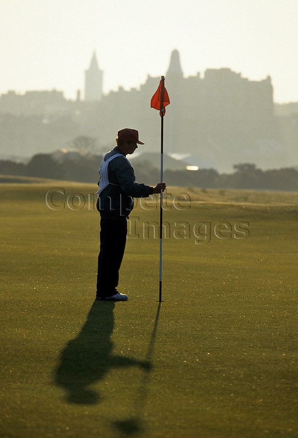 Golf caddy holding flag