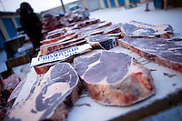 Stall with deep-frozen cut meat at the Yakutsk outdoor meat market. Yakutsk is one of the coldest cities on earth, with winter temperatures averaging -40.9 degrees Celsius.