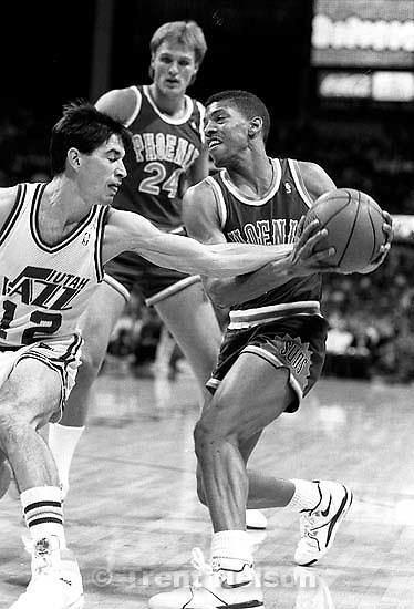 John Stockton reaches in on Kevin Johnson at Utah Jazz vs. Phoenix Suns basketball.<br />