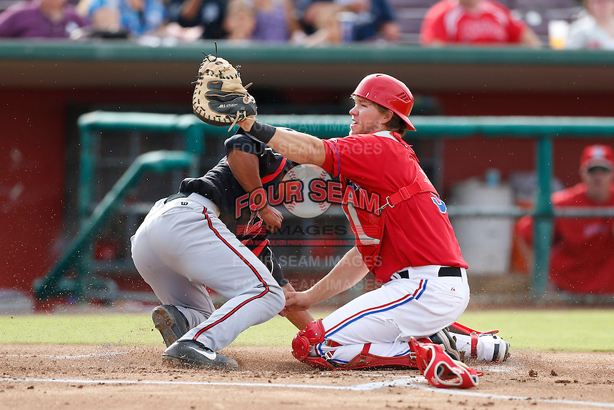 Abel Baker #9 of the the Inland Empire 66'ers shows the ball to the umpire after a play at the plate during a game against the Lake Elsinore Storm at San Manuel Stadium on June 23, 2013 in San Bernardino, California. Lake Elsinore defeated Inland Empire, 6-2. (Larry Goren/Four Seam Images)