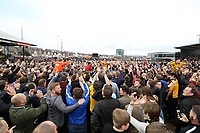 A pitch invasion occurs after the final whistle as a late goal from Mark O'Brien secures safety for Newport to stay in League two during the Sky Bet League Two match between Newport County and Notts County at Rodney Parade, Newport, Wales, UK. Saturday 06 May 2017