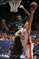 Ohio State's Matt Sylvester, 40, throws up a shot that is easily blocked by Georgetown's Roy Hibbert, 55, in the second half of Ohio State's NCAA game against Georgetown at the University of Dayton arena, March 19, 2006. Ohio State lost the contest 70 - 52. (Dispatch photo by Neal C. Lauron)
