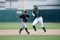 Chicago White Sox second baseman Lenyn Sosa (13) applies the tag to Lawrence Butler (14) during an Instructional League game against the Oakland Athletics at Lew Wolff Training Complex on October 5, 2018 in Mesa, Arizona. (Zachary Lucy/Four Seam Images)