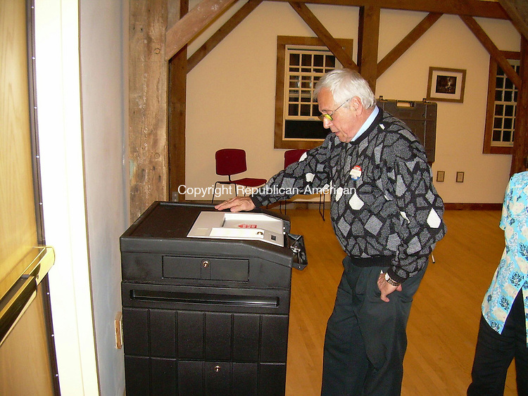 COLEBROOK, CT - 03 May 2011 - 050311KM01 - Colebrook moderator Ron Dorazio prepares the ballot machine for tallying votes at Tuesday's budget referendum. Voters approved the budget 179 to 169. Kurt Moffett Republican-American